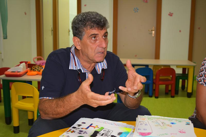 Dr Pietro Bartolo sits in the childrens playroom at the hospital in Lampedusa which has been set up especially for migrant and refugee children