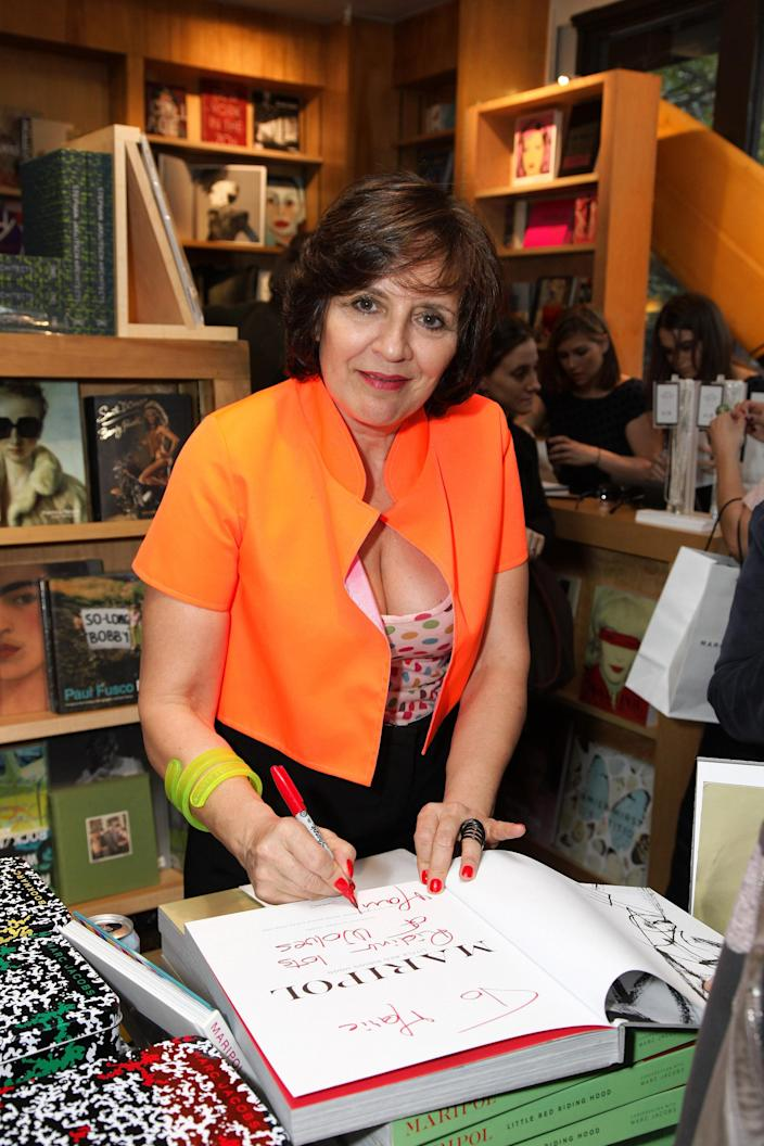 Maripol signing a book at the launch party for <em>Maripol: Little Red Riding Hood</em> in 2010. (Photo: Neilson Barnard/Getty Images)