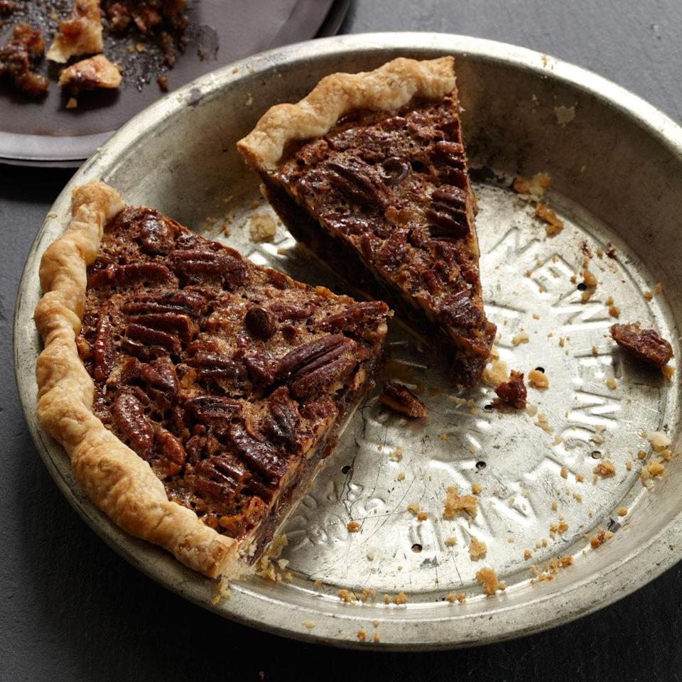 """<p>It's hard to go wrong with bourbon and chocolate. Coarsely chopping the pecans makes the pie easy to slice, but you can sprinkle some whole ones on top to make it look extra pretty. <a href=""""http://www.foodandwine.com/recipes/chocolate-pecan-pie-with-bourbon"""" rel=""""nofollow noopener"""" target=""""_blank"""" data-ylk=""""slk:Get the recipe for Food & Wine's Pecan Pie With Bourbon here."""" class=""""link rapid-noclick-resp""""><b>Get the recipe for Food & Wine's Pecan Pie With Bourbon here</b>.</a> (<i>Photo: Lucy Schaeffer)</i></p>"""