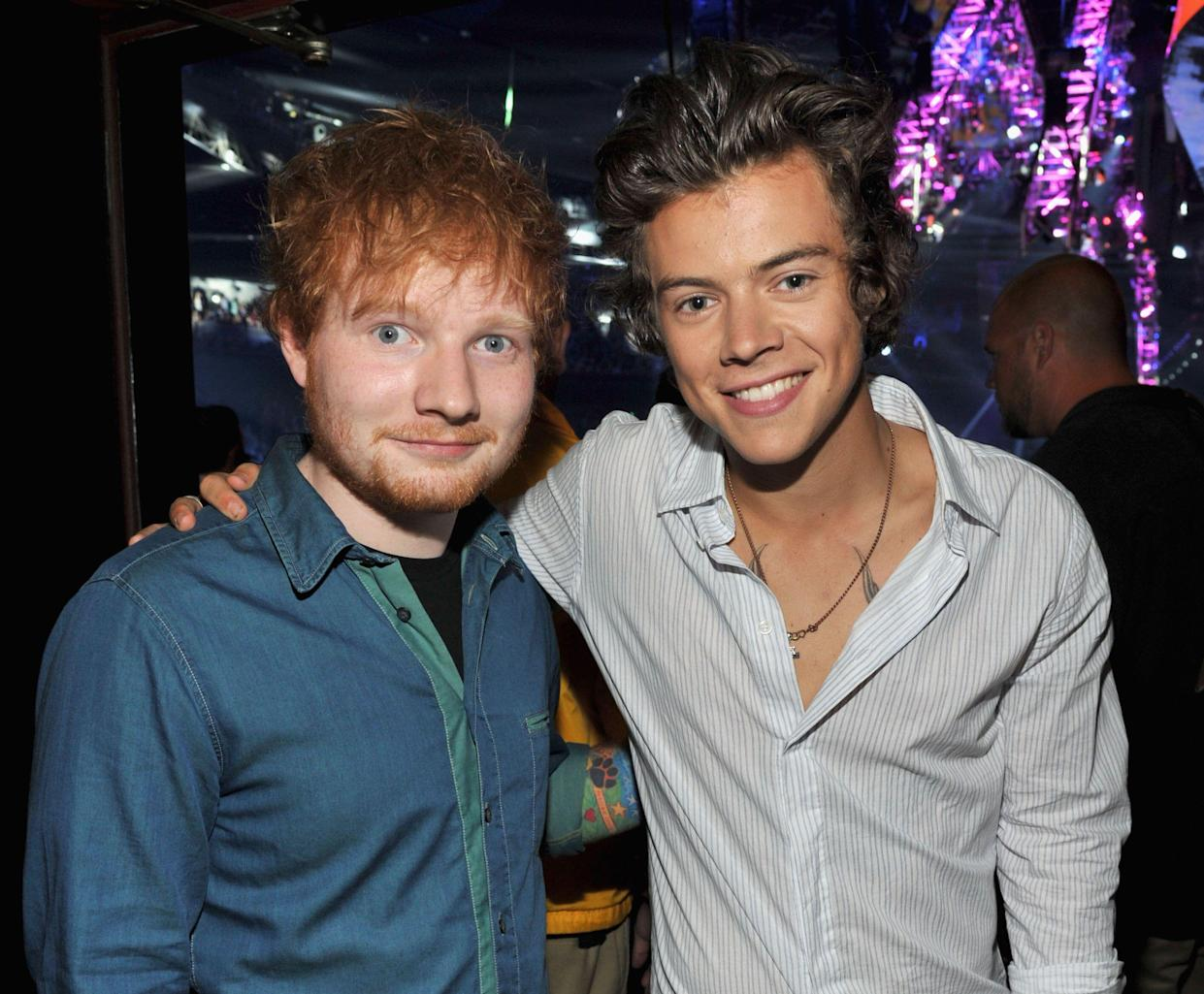 Musicians Ed Sheeran (L) and Harry Styles of One Direction attend the 2013 Teen Choice Awards at Gibson Amphitheatre on August 11, 2013 in Universal City, California. (Photo by Kevin Mazur/Fox/WireImage)