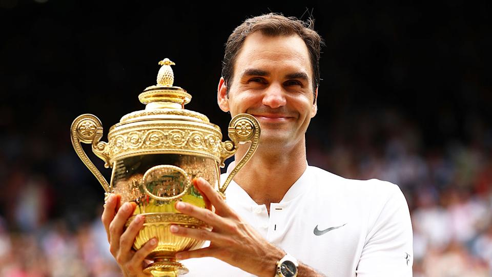 Roger Federer is pictured here holding the Wimbledon trophy he won in 2017.