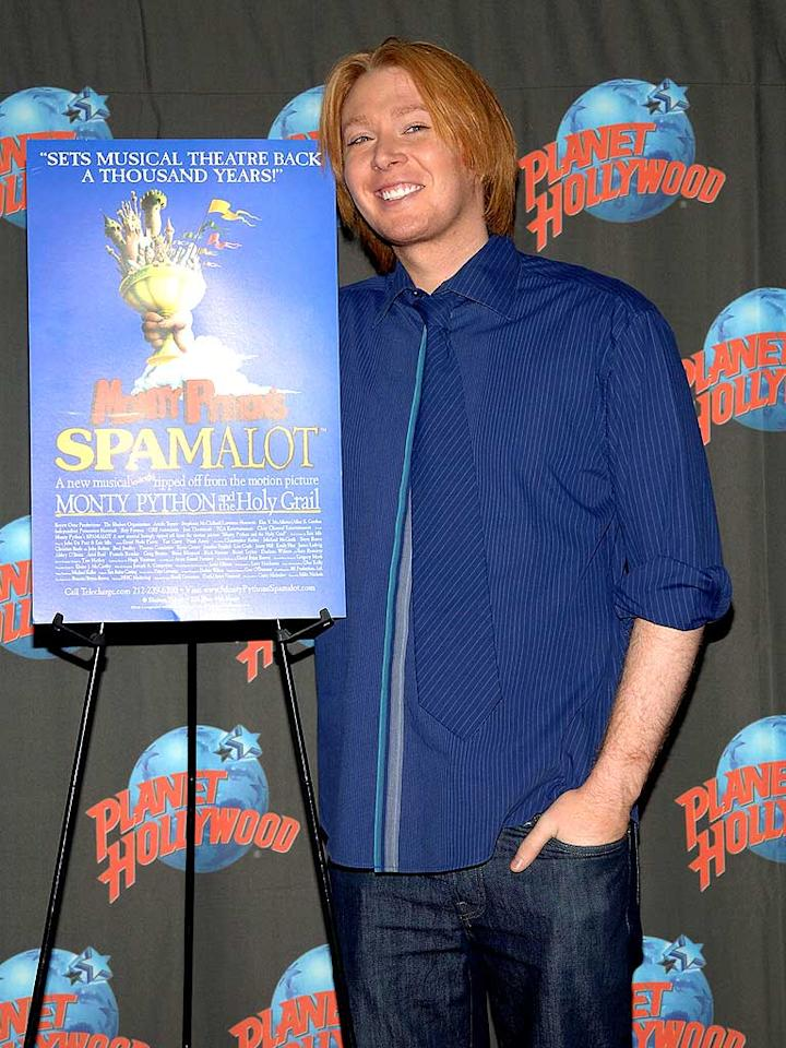 """Former """"American Idol"""" contestant and current Broadway star Clay Aiken poses next to a """"Spamalot"""" poster during a handprinting ceremony at Planet Hollywood in Times Square. Duffy-Marie Arnoult/<a href=""""http://www.wireimage.com"""" target=""""new"""">WireImage.com</a> - April 8, 2008"""
