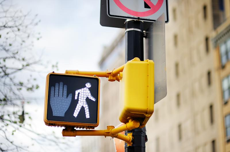 A walking signal at a New York crossing. The fake petition claimed people were offended by the figure.