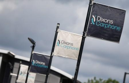 FILE PHOTO: Signs display the logo of Dixons Carphone at the company headquarters in London
