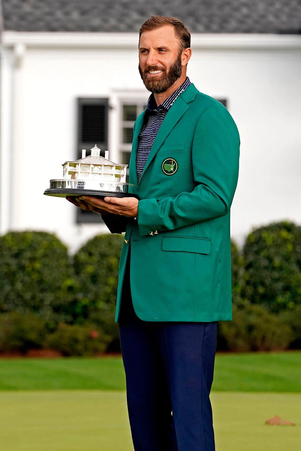 Dustin Johnson celebrates after winning the 2020 Masters.