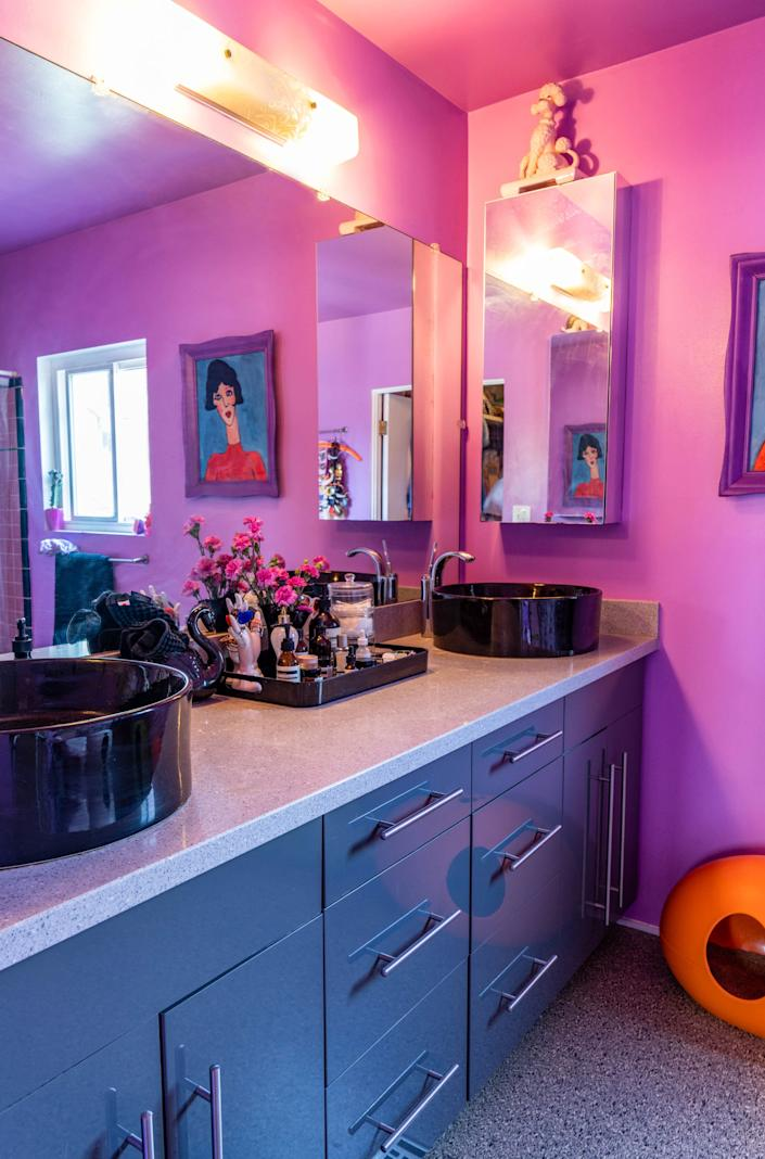 "<div class=""caption""> Luckily there is more than one bathroom, so Candice could add purple to the rainbow interior. </div>"