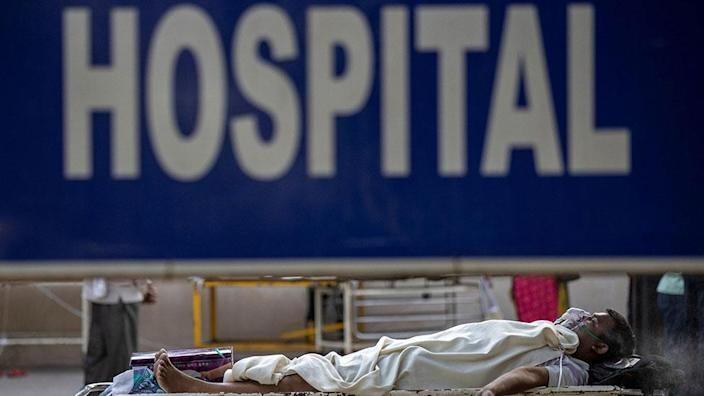 Patients outside an Indian hospital