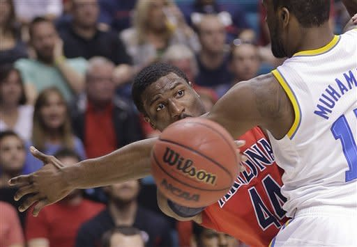 Arizona's Solomon Hill (44) passes against UCLA's Shabazz Muhammad in the first half of a semifinal Pac-12 tournament NCAA college basketball game, Friday, March 15, 2013, in Las Vegas. (AP Photo/Julie Jacobson)
