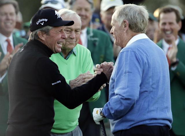From left, Gary Player, Arnold Palmer and Jack Nicklaus shake hands after hitting ceremonial drives on the first tee during the first round of the Masters golf tournament Thursday, April 10, 2014, in Augusta, Ga. (AP Photo/Charlie Riedel)
