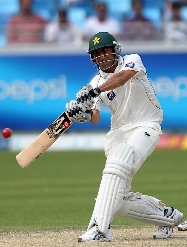 Pakistan's cricketer Younis Khan plays a shot during the second day of the third and final Test match between Pakistan and England at the Dubai International Cricket Stadium at Dubai Sports City on February 4, 2012.  England were bowled out for 141 in their first innings on the second day of the third and final Test that gives them a 42-run lead over Pakistan's first innings total of 99.  AFP PHOTO/ LAKRUWAN WANNIARACHCHI (Photo credit should read LAKRUWAN WANNIARACHCHI/AFP/Getty Images)