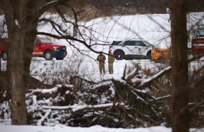Investigators are shown Thursday, Jan, 21, 2021,  on the scene of a fatal military helicopter crash that occurred Wednesday near West Bloomfield Road in Mendon.