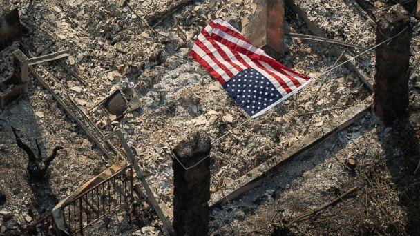 PHOTO: An American flag flies over the remains of a Coffey Park home following the Tubbs fire in Santa Rosa, Calif. (Noah Berger/San Francisco Chronicle/Polaris)