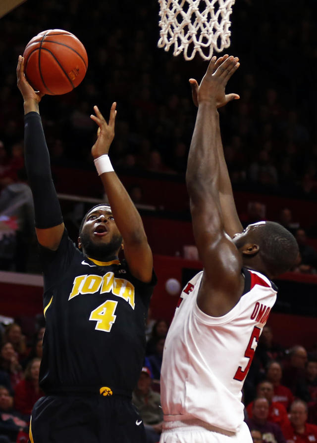 Iowa guard Isaiah Moss (4) shoots over Rutgers forward Eugene Omoruyi (5) during the first half of an NCAA college basketball game Saturday, Feb. 16, 2019, in Piscataway, N.J. (AP Photo/Adam Hunger)