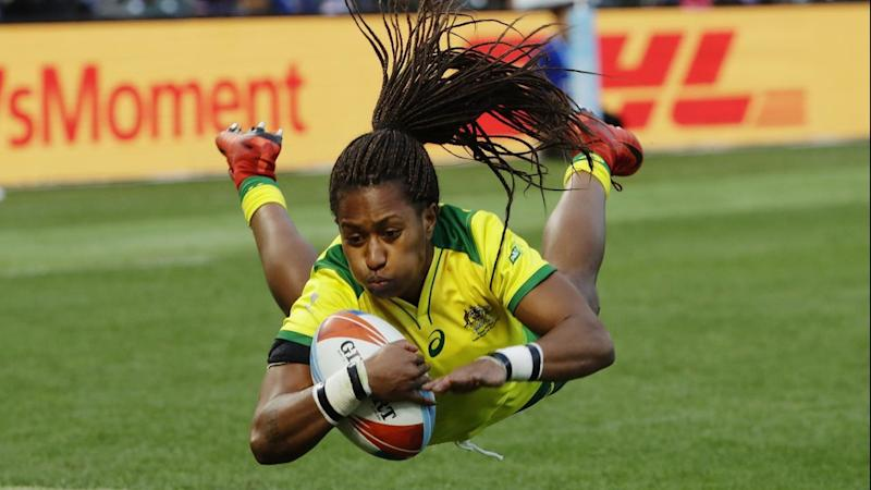 Australia's Ellia Green dives over to score against the United States in San Francisco