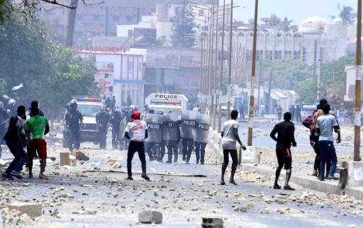 Students throw stones at Senegalese police during a protest outside the University Cheikh Anta Diop in Dakar on May 16