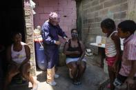 Nurse Rosaura Rodriguez inoculates a woman with a dose of the Sinopharm COVID-19 vaccine during house to house vaccinations in the popular neighborhood of El Valle in Caracas, Venezuela, Monday, Sept. 27, 2021. According to the Pan American Health Organization Venezuela one of the least vaccinated countries in the continent, is seeing a growing uptick in caseloads, unlike other countries in the region where cases are dropping. (AP Photo/Ariana Cubillos)