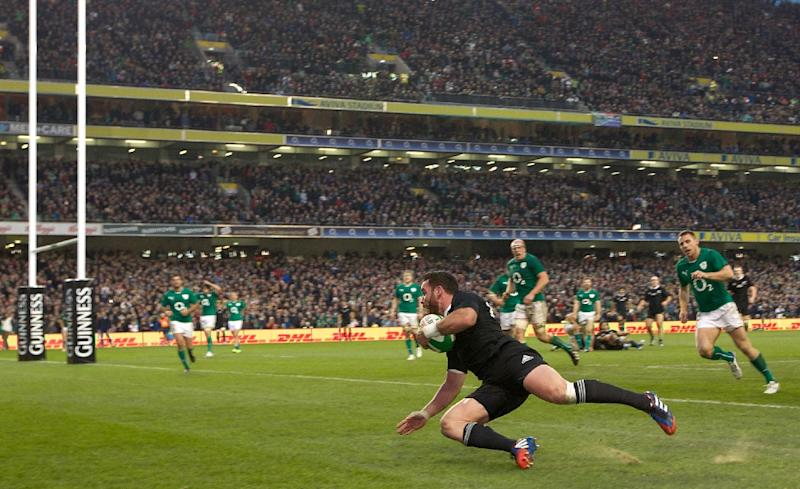 New Zealand's centre Ryan Crotty scores a try during their int'l rugby union Test match against Ireland, at Aviva Stadium in Dublin, in November 2013
