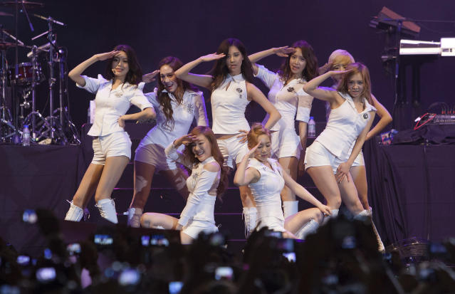 South Korean pop girl group Girl's Generation perform during the Twin Towers Alive concert, held in conjunction with the Malaysian Formula One Grand Prix in Kuala Lumpur, Malaysia, Friday, March 23, 2012. (AP Photo/Ching Kien Huo)