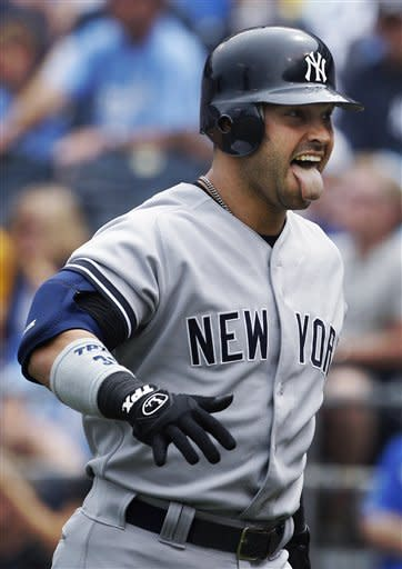 New York Yankees' Nick Swisher returns to the dugout after hitting a solo home run during the third inning of a baseball game against the Kansas City Royals in Kansas City, Mo., Sunday, May 6, 2012. (AP Photo/Orlin Wagner)