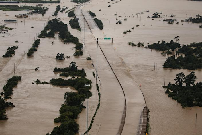 <p>Portions of the Interstate 10 remains flooded in the wake of Hurricane Harvey after it dumped up to 50 inches of rain in Houston, Texas, on Aug. 29, 2017. (Photo: Marcus Yam / Los Angeles Times via Getty Images) </p>
