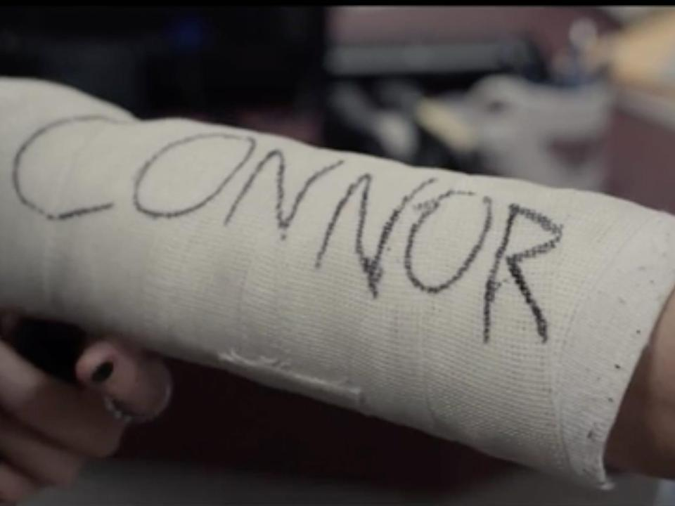 Evan Hansen's cast with the name Connor on it.