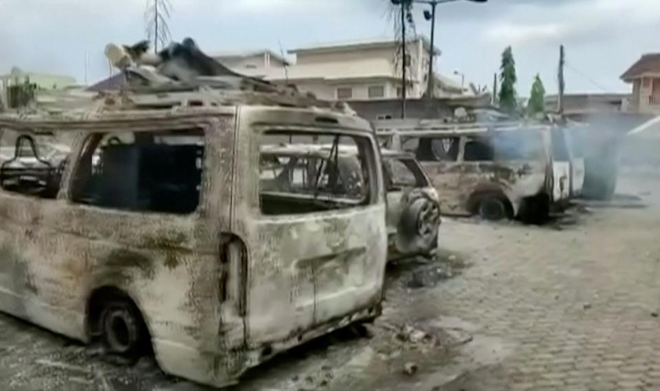 Burnt vehicles outside the TVC television station in LagosReuters TV