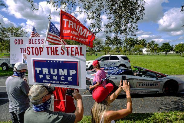 PHOTO: In this Nov. 29, 2020, file photo, people take photos of the bus dedicated for March for Trump bus tour, a two week multi-state rally in support of President Donald Trump, in Doral, Fla. (Maria Alejandra Cardona/Reuters via Newscom, FILE)