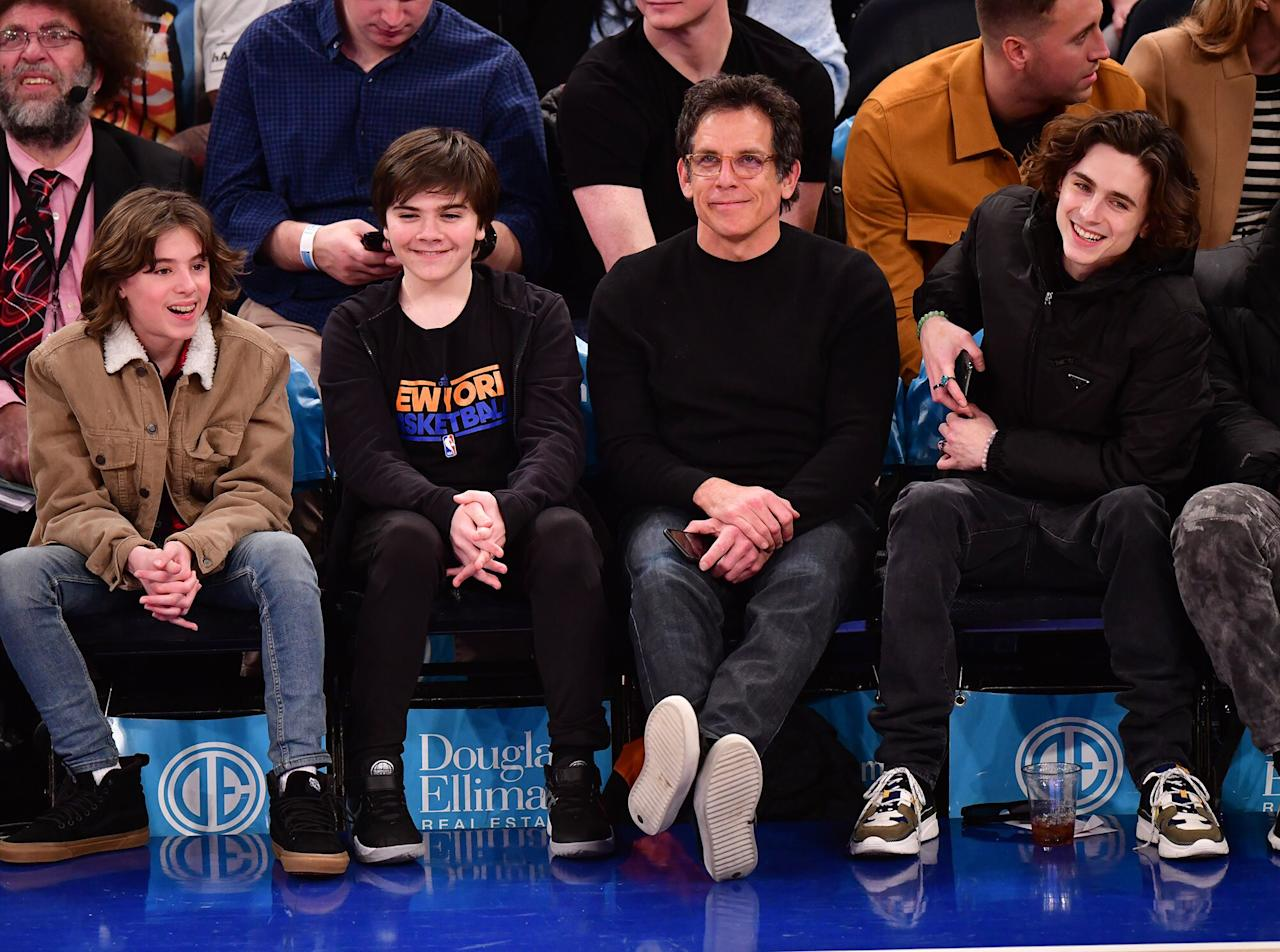 Ben Stiller and his son are joined by Timothée Chalamet at the Toronto Raptors vs. New York Knicks basketball game at Madison Square Garden in New York City on Friday.
