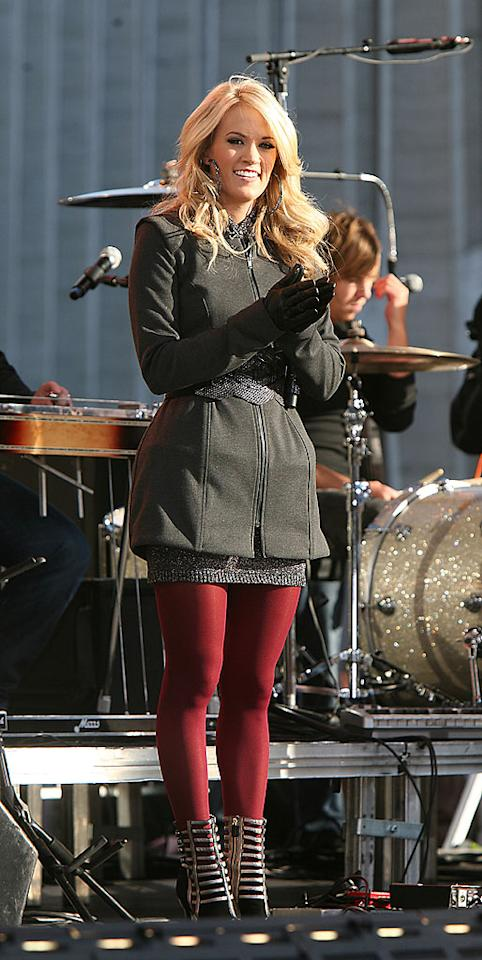 """Meanwhile, Reese's BFF Carrie Underwood brought her cuteness to the chilly """"Good Morning America"""" concert stage in a belted wool coat, red leggings, futuristic booties, and huge hoop earrings. Jennifer Mitchell/<a href=""""http://www.splashnewsonline.com"""" target=""""new"""">Splash News</a> - November 3, 2009"""