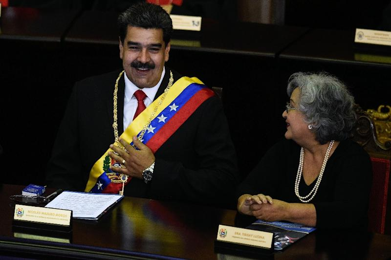 Nicolas Maduro appears at an opening ceremony of the Supreme Court of Justice with Tibisay Lucena, chair of the National Electoral Council, after the United States declared that he is no longer the legitimate president of Venezuela (AFP Photo/Federico PARRA)