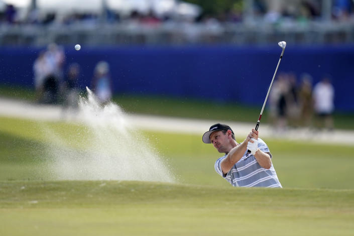 Juston Rose hits out of the sand onto the 18th green during the third round of the PGA Zurich Classic golf tournament at TPC Louisiana in Avondale, La., Saturday, April 24, 2021. (AP Photo/Gerald Herbert)