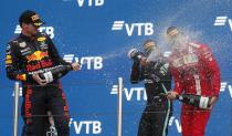 Mercedes' Lewis Hamilton, center, celebrates on the podium after winning the race alongside second place Red Bull's Max Verstappen and third place Ferrari's Carlos Sainz Jr. during the Russian Formula One Grand Prix at the Sochi Autodrom circuit, in Sochi, Russia, Sunday, Sept. 26, 2021. (Yuri Kochetkov/Pool Photo via AP)