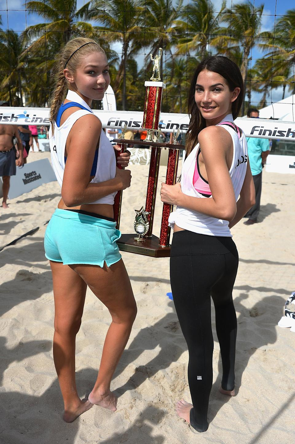 Gigi Hadid and Lily Aldridge attend the Sports Illustrated Swimsuit 2014 Beach Volleyball event.