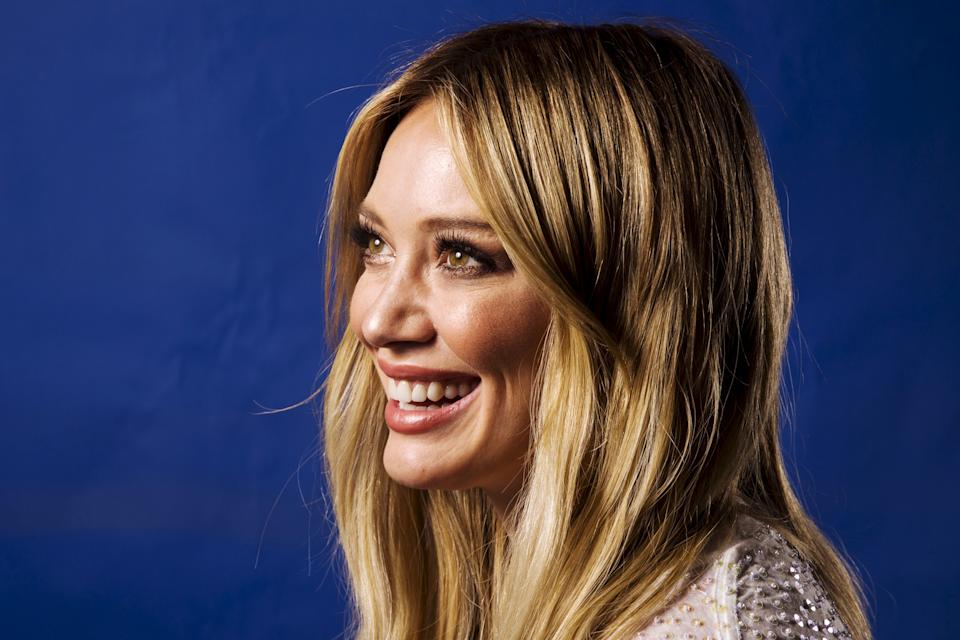 """Actress and singer Hilary Duff poses for a portrait while promoting her new album """"Breathe In. Breathe Out."""" in New York June 17, 2015. REUTERS/Lucas Jackson"""