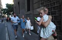 <p>People flee the scene in Barcelona, Spain, Aug. 17, 2017 after a white van jumped the sidewalk in the historic Las Ramblas district, crashing into a summer crowd of residents and tourists and injuring several people, police said. (Giannis Papanikos/AP) </p>
