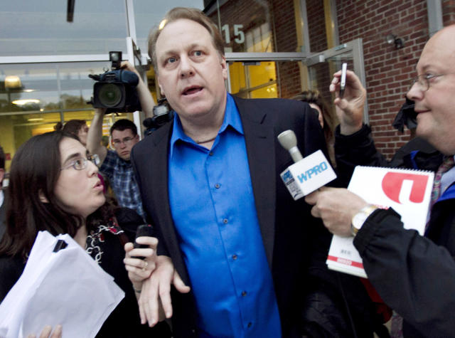 <p> FILE - In this May 21, 2012 file photo, former Boston Red Sox pitcher Curt Schilling, center, departs the Rhode Island Economic Development Corporation headquarters in Providence, R.I. Attorneys representing Schilling and others at his former startup, 38 Studios, on Friday, March 1, 2013, filed documents asking Superior Court Judge Michael Silverstein to dismiss a state economic development agency lawsuit over its $75 million loan guarantee for his now-defunct video game company. (AP Photo/Steven Senne, File) </p>