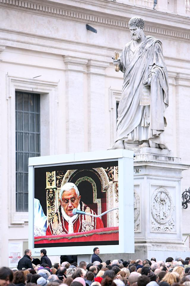 VATICAN CITY, VATICAN - DECEMBER 25:  Pope Benedict XVI is projected on a screen to the crowd as he delivers his Christmas Day message from the central balcony of St Peter's Basilica on December 25, 2012 in Vatican City, Vatican. The 'Urbi et Orbi' (to the city and to the world) is recognised as a Christmas tradition by Catholics with the Pope focusing this year on the conflict in Syria, calling for a political solution. (Photo by Franco Origlia/Getty Images)