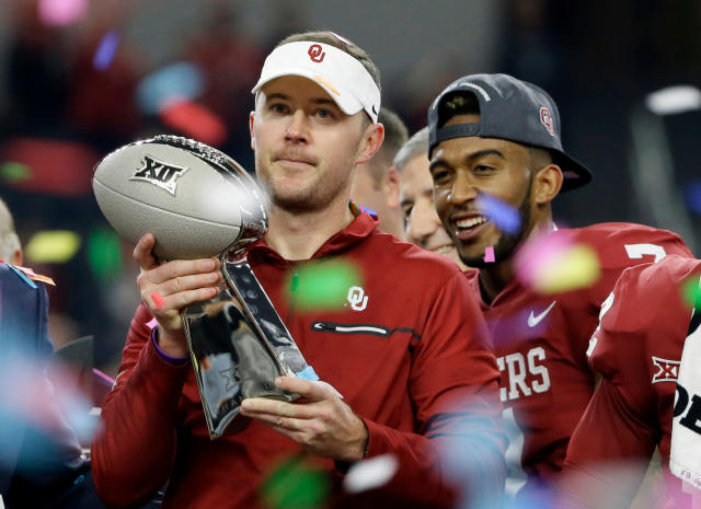 FILE - In this Dec. 2, 2017, file photo, Oklahoma head coach Lincoln Riley holds the Big 12 Conference championship NCAA college football game trophy after Oklahoma defeated TCU, in Arlington, Texas. Riley has already led Oklahoma to the College Football Playoff and another Big 12 title with a Heisman Trophy-winning quarterback. Now Riley has completed his first spring as head coach of the Sooners. Yeah, we did this one backward kind of ... having been through a whole season, now this is kind of my first spring practice, Riley said.(AP Photo/Tony Gutierrez, Fil)