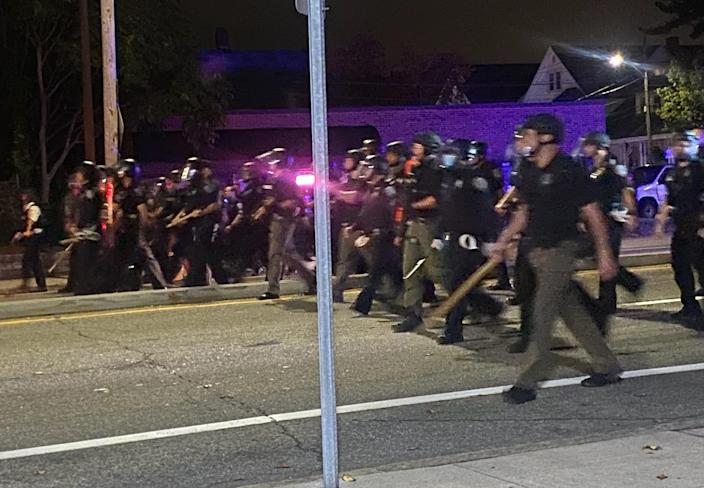 Police face protesters near the border between Providence and Cranston, Rhode Island, Wednesday night.