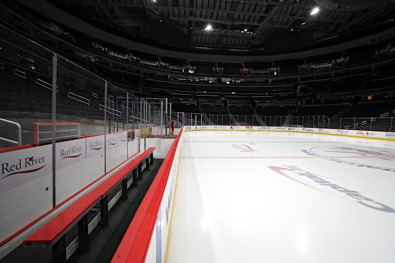 WASHINGTON, DC - MARCH 12: The ice, player's bench, and spectator seating are empty prior to the Detroit Red Wings playing against the Washington Capitals at Capital One Arena on March 12, 2020 in Washington, DC. Yesterday, the NBA suspended their season until further notice after a Utah Jazz player tested positive for the coronavirus (COVID-19). The NHL said per a release, that the uncertainty regarding next steps regarding the coronavirus, Clubs were advised not to conduct morning skates, practices or team meetings today. (Photo by Patrick Smith/Getty Images)
