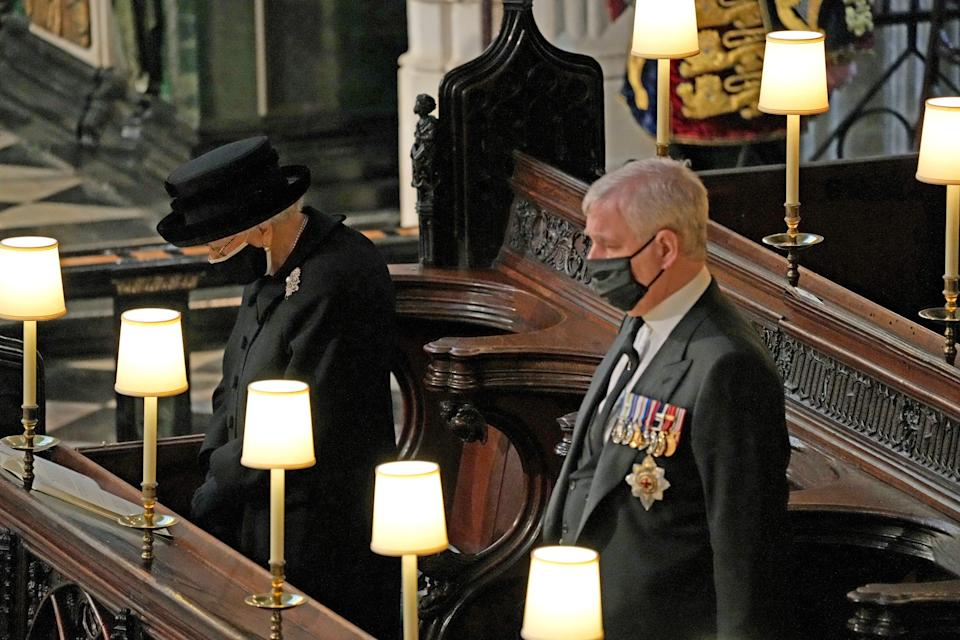 Britain's Queen Elizabeth II (L) and Britain's Prince Andrew, Duke of York attend the funeral service of Britain's Prince Philip, Duke of Edinburgh inside St George's Chapel in Windsor Castle in Windsor, west of London, on April 17, 2021. - Philip, who was married to Queen Elizabeth II for 73 years, died on April 9 aged 99 just weeks after a month-long stay in hospital for treatment to a heart condition and an infection. (Photo by Yui Mok / POOL / AFP) (Photo by YUI MOK/POOL/AFP via Getty Images)