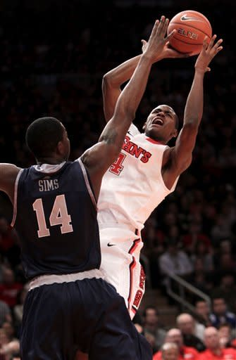 St. John's Moe Harkless, right, shoots over Georgetown's Henry Sims during the second half of an NCAA college basketball game in New York, Sunday, Jan. 15, 2012. Georgetown beat St. John's 69-49. (AP Photo/Seth Wenig)