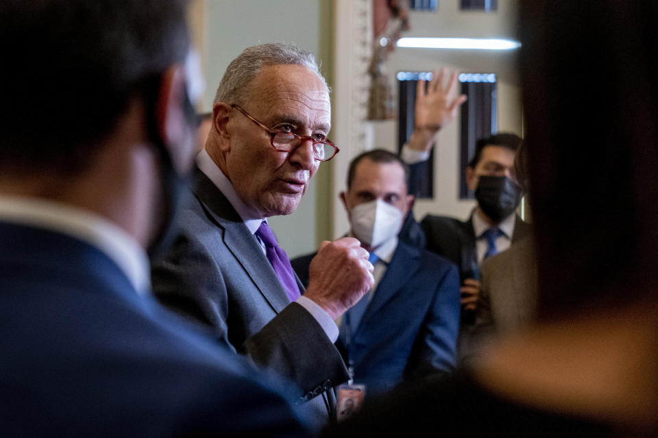 Senate Majority Leader Chuck Schumer, D-N.Y., speaks to reporters as work continues on the Democrats' Build Back Better Act, massive legislation that is a cornerstone of President Joe Biden's domestic agenda, at the Capitol, in Washington, Tuesday, Sept. 14, 2021. (AP Photo/Andrew Harnik)