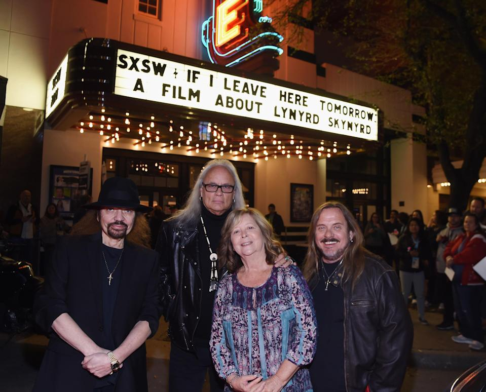 Lynyrd Skynyrd members Gary Rossington, Rickey Medlocke, and Johnny Van Zant attend the <em>If I Leave Here Tomorrow</em> movie premiere at SXSW with Ronnie Van Zant's widow, Judy. (Photo: R. Diamond/Getty Images for CMT)