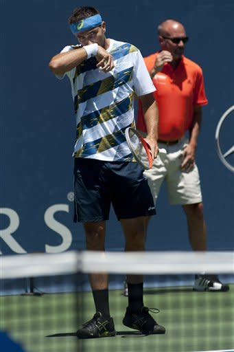 Marinko Matosevic, of Australia, wipes his face between points in a semifinals singles match against Ricardas Berankis, of Lithuania, at the Farmers Classic tennis tournament, Saturday, July 28, 2012, in Los Angeles. (AP Photo/Grant Hindsley)