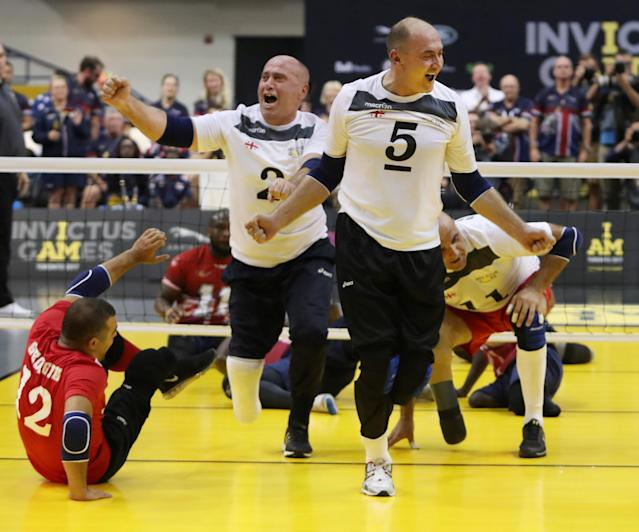 Sitting Volleyball team from Georgia reacts as they score final point to win the gold medal at the Invictus Games in Toronto, Ontario, Canada, September 27, 2017. REUTERS/Fred Thornhill