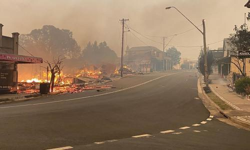 NSW fires: two men dead, one missing and homes destroyed by bushfires on south coast