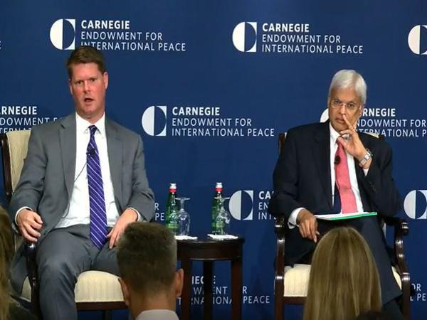 Former US assistant secretary of defense Randall G. Schriver (On the left)