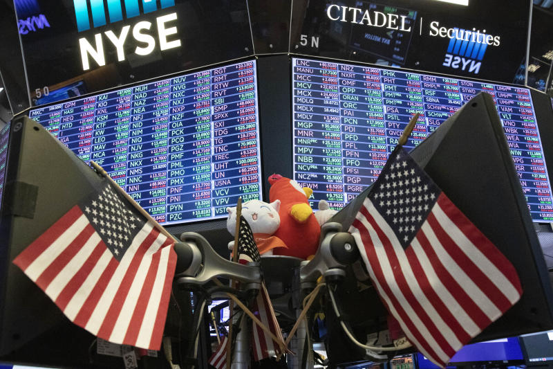 FILE - In this Sept. 18, 2019, file photo stock prices are displayed at the New York Stock Exchange. Investors hit the brakes on a hard-charging market over the last two quarters as the U.S.-China trade war created an uncertain economic path forward. (AP Photo/Mark Lennihan, File)