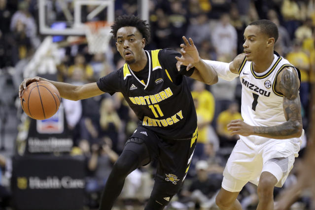 Northern Kentucky's Jalen Tate (11) dribbles around Missouri's Xavier Pinson (1) during the first half of an NCAA college basketball game Friday, Nov. 8, 2019, in Columbia, Mo. (AP Photo/Jeff Roberson)
